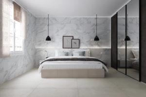 Dormitorio con paredes de cerámica de gran formato